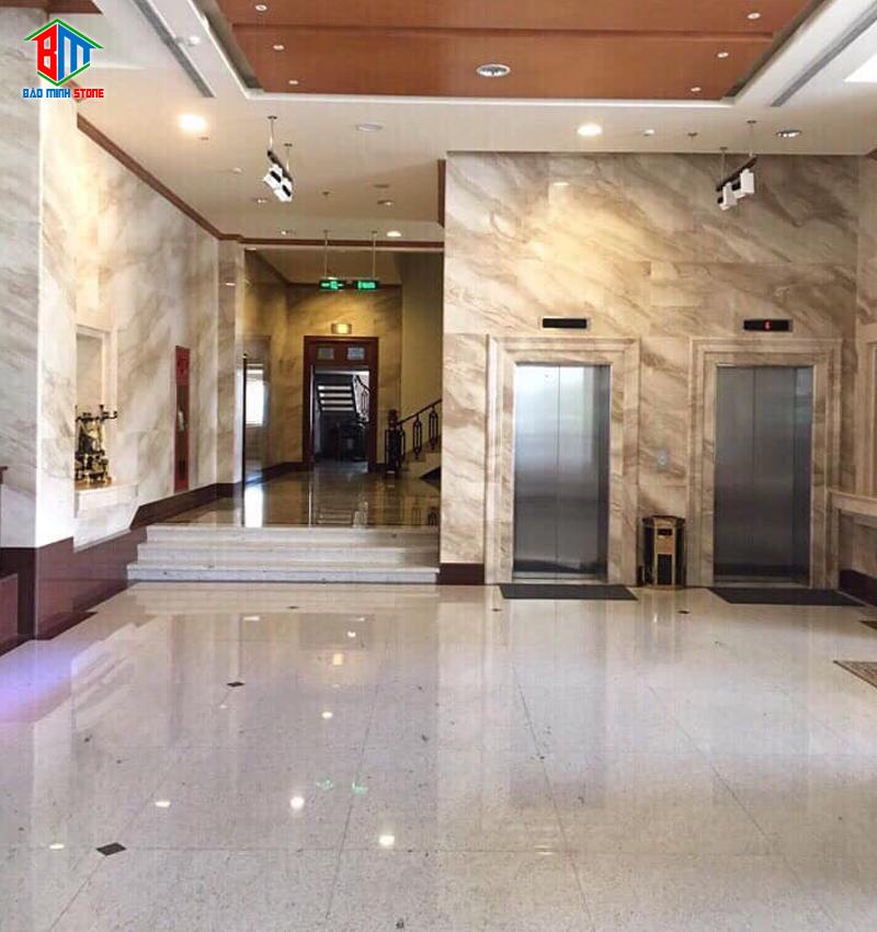 Liên hệ Bảo Minh Stones thi công ốp mặt tiền thang máy